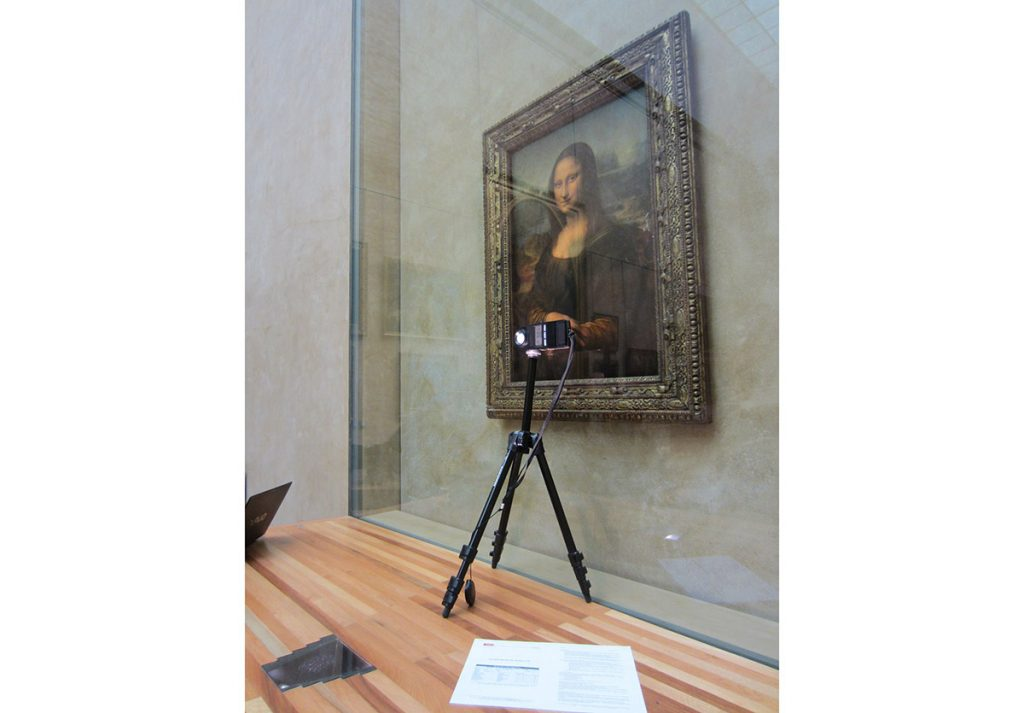 Assessment and adjustments of the accent lighting with the LED spot located in the shelf in front of the Mona Lisa.